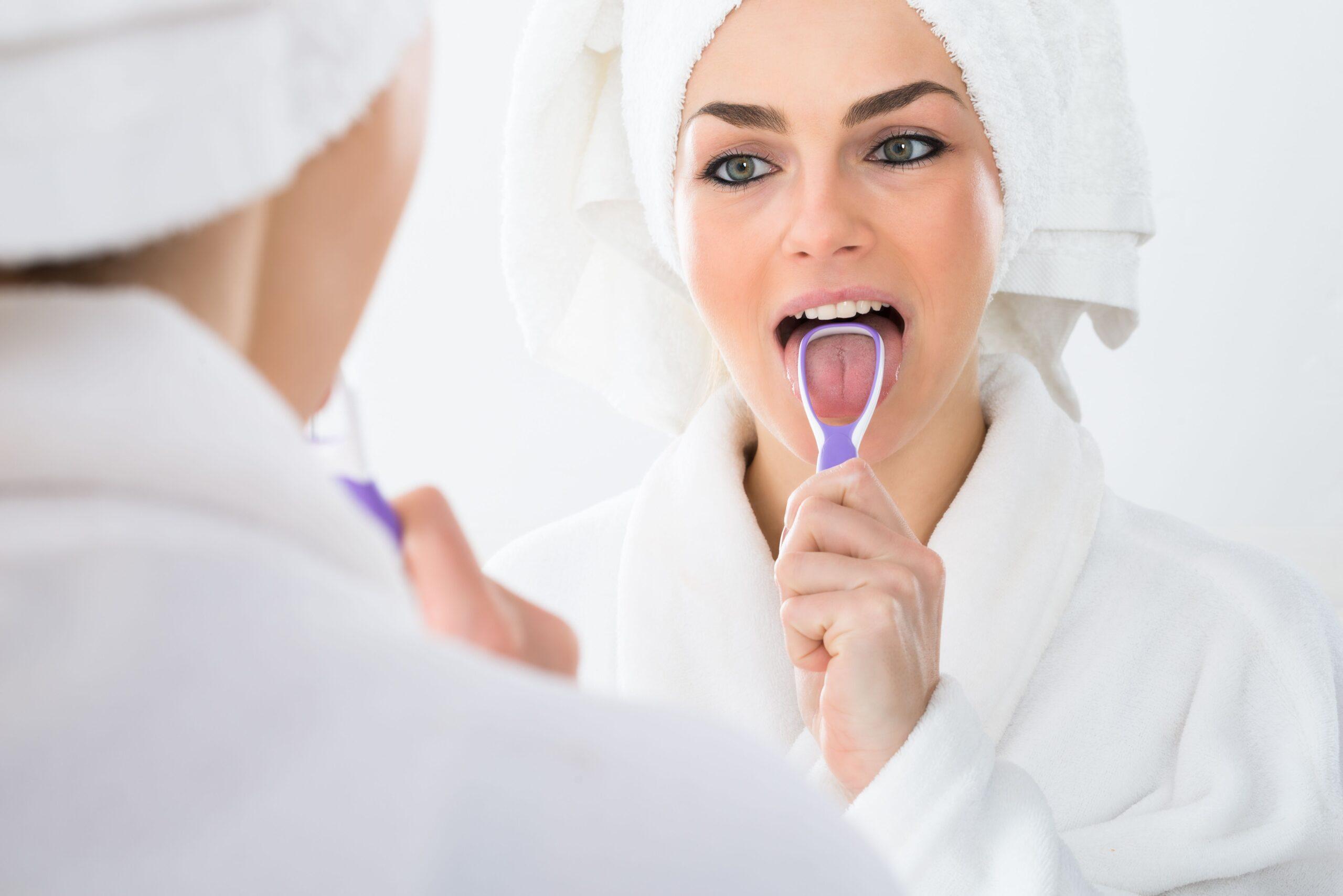 Dentist Edmond | Should I Be Using a Tongue Scraper?